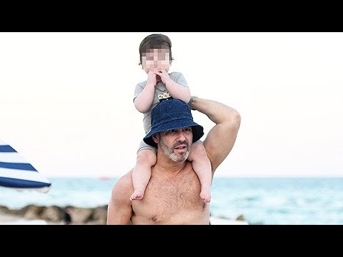 andy-cohen,-51,-reveals-impressive-abs-while-playing-with-adorable-son-benjamin,-11-mos.,-on-beach