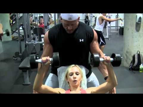 female fitness model training for chest biceps triceps