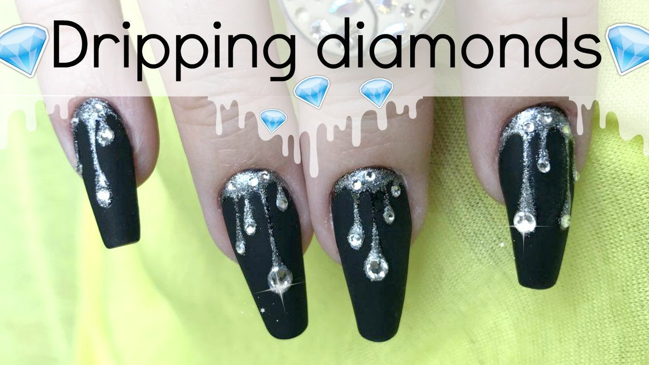 Dripping rhinestone nail design