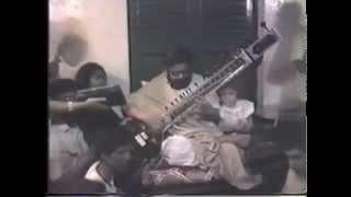 Thakur Sri Sri Balak Brahmachari Maharaj playing Sitar