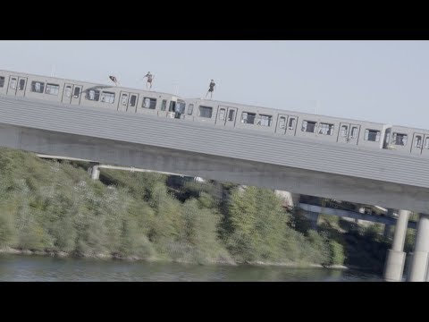Daredevils Jump From Moving Train