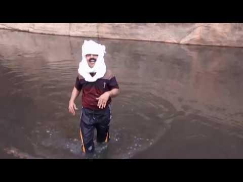 The great Indian traveler at  -sahara desert oasis