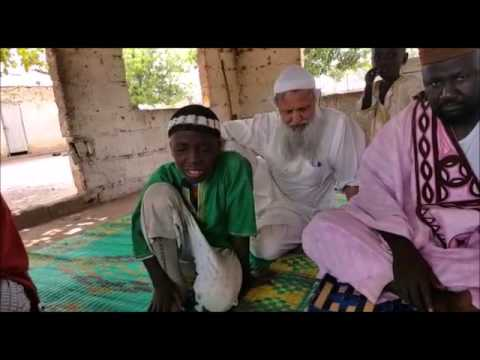 A student in Gambia Reciting the Quran