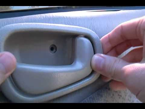 How To Replace The Interior Door Handle Of A 1998 Toyota Corolla