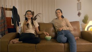 Young Indian girls having fun during movie time at a sleepover