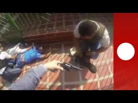 """Dramatic shootout between Colombian police and burglars """"caught red handed"""""""