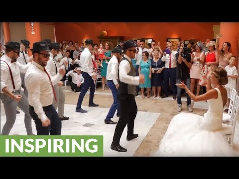 Groom and friends deliver surprise performance for bride