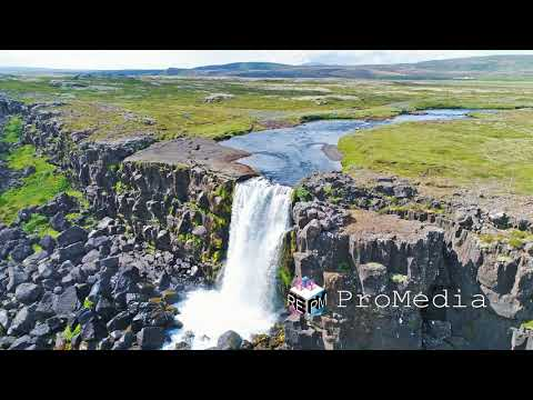 Fly through tectonic rifts around  Oxararfoss waterfall in Pingvellir national park in Iceland