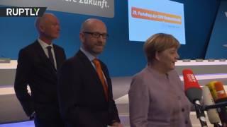 Merkel press statement interrupted by 360 degree camera