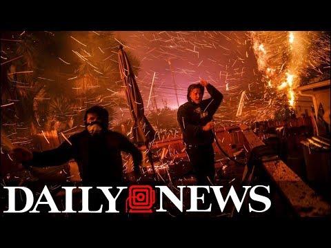 New wildfire spreads alongside Los Angeles highway,