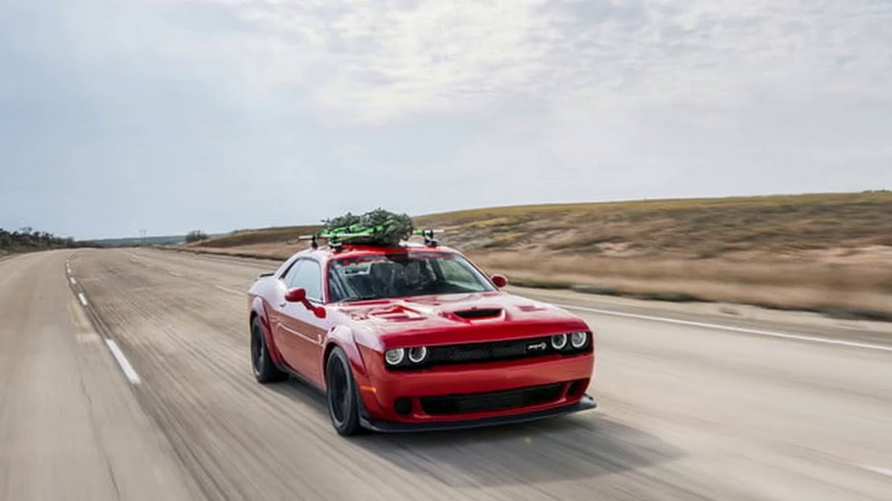 hellcat dodge challenger hennessey hits 174 mph with a christmas tree on its roof