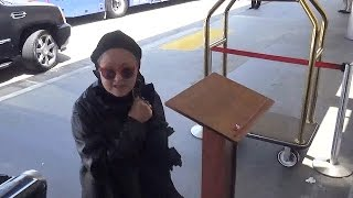 Cyndi Lauper Goes Incognito Through LAX