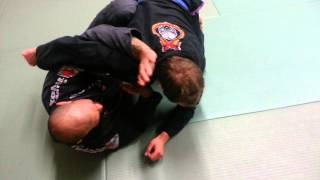 straight arm lock from bottom half guard