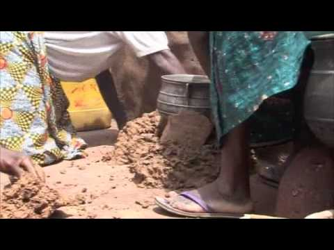 Making mud stoves in Togo