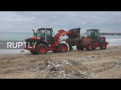 Indonesia: Workers, volunteers remove plastic waste piled up on Bali beach
