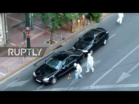 LIVE: Forensic officers investigate scene following explosion in former Greek PM Papademos' car