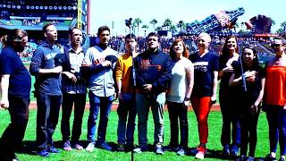 The cast of 'La Cage aux Folles' sing the National Anthem at SF Giants game