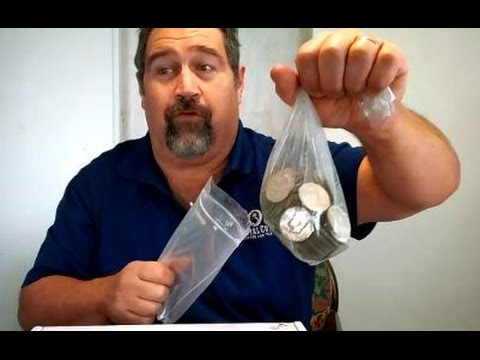 Watch me open a bag of 200 silver coins.. Half dollars