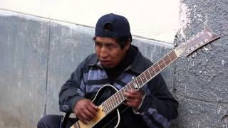 Travel Songs: Street Performer - Paucartambo, Peru