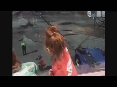 Young girls have impromptu dance-off with airport employee