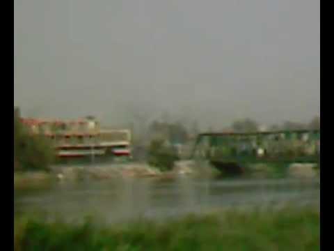 U.S. bomb strike in Iraq [white building across bridge]