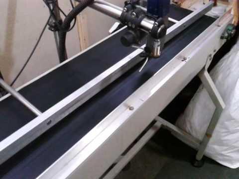 Inkjet printer with conveyor printing on metal can