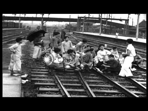 Students demonstrate at railroad station in Shanghai, China. HD Stock Footage