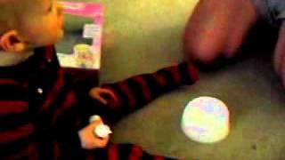 Baby boy plays with potty doll