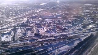 . Чита. Посадка самолета ТУ-214 в Аэропорт Кадала с разворотом над городом(Посадка самолета ТУ-214 в Аэропорт Кадала с разворотом над городом Чита зимой. Полет с авиакомпанией