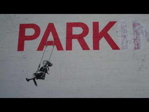 Banksy in LA - Girl Swings in the PARKing lot