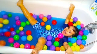 Kids play with water balloons and toys in the bathtub, kids boys