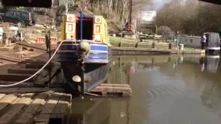 Historic narrow boat Joel being launched from slipway