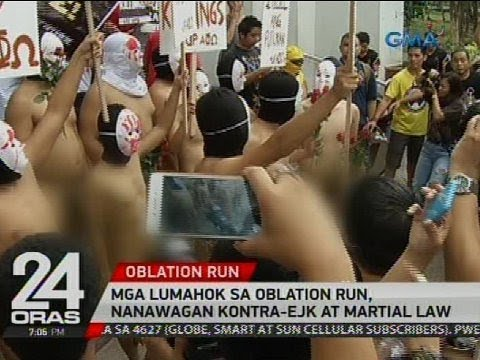 Oblation Run participants call for end to killings, martial law in