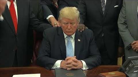 Faith leaders put hands on Trump and pray