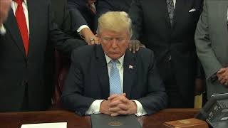 Faith leaders put hands on Trump and pray. But does he pray?