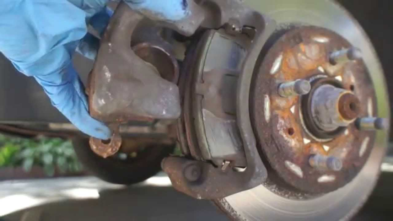 How to Replace Rotor and Brake Pads on a 2004 Mitsubishi Lancer ES