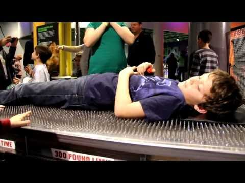 Jackson lays on a bed of nails @ Discovery Place Charlotte, NC