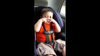 William doing his magic hands in the car. 3 years old. Non verbal autism