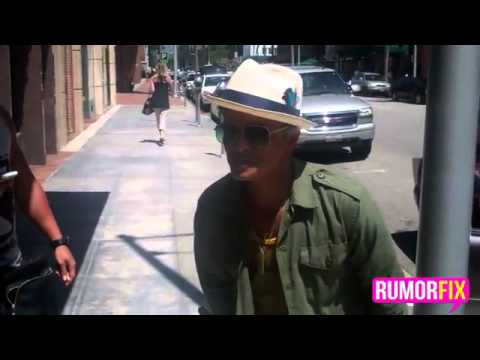 Bruno Mars talking to the paparazzi after he leaves the doctorsflv