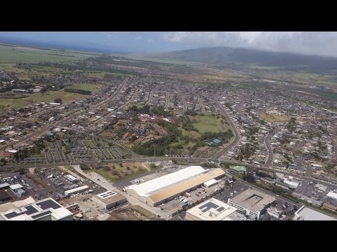(HD) Flying over Kahului town Maui Hawaii from the air - Scenic flight