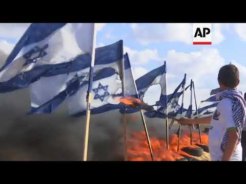 Palestinian Protesters Burn Israeli Flags In Border Area