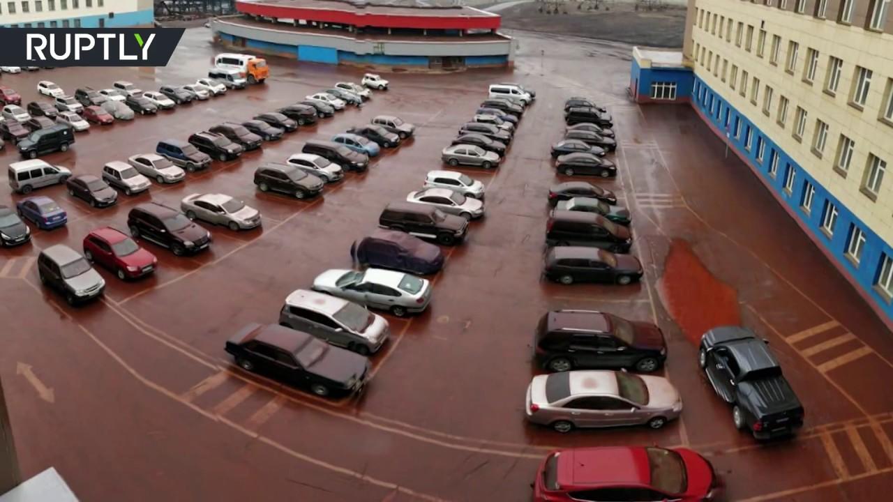 Siberia going biblical? 'Blood rain' pours down on Russian parking lot