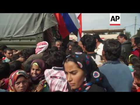 Syrian, Russia troops deliver aid in Syria