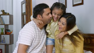 4K Stock Footage of a happy nuclear Indian family in their bedroom - Young cute daughter and young indian parents
