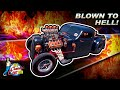 Hot Rods, Burnouts & Pinups | Frankenstein Coffin Car with Skull Headlights