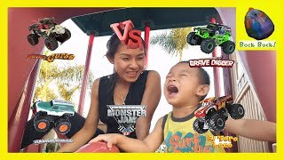 Hotwheels Monster Jam truck racing and finding surprise egg Grave Digger El Toro Loco Pirate Curse