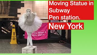 Moving Statue in Subway Pen station. New York City.