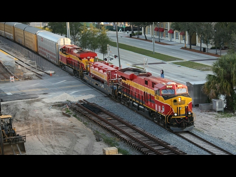 FEC freight passing the Brightline station in West Palm Beach