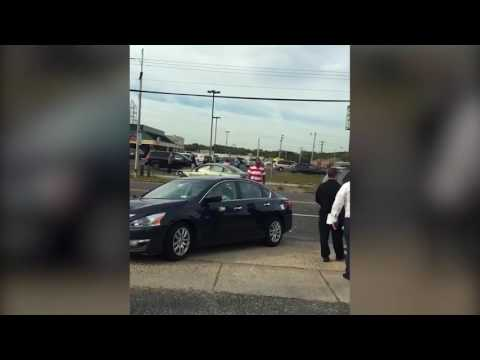 Man lashes out at bystanders after crash