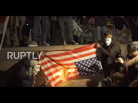UK: US flag burns at London's 'Million Mask March'